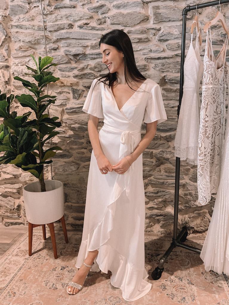 bride in satin white high-low wrap dress