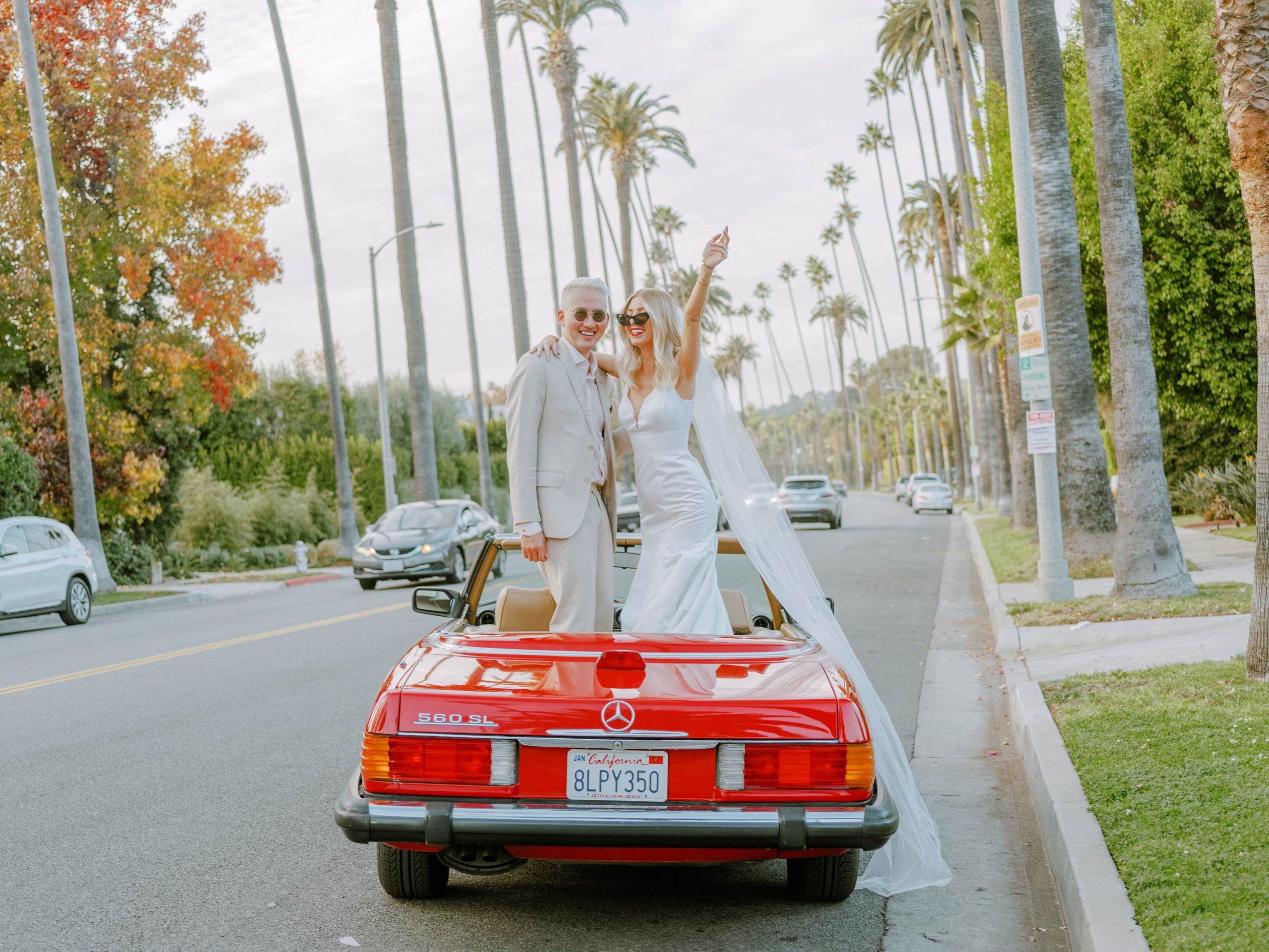 couple dancing in red convertible