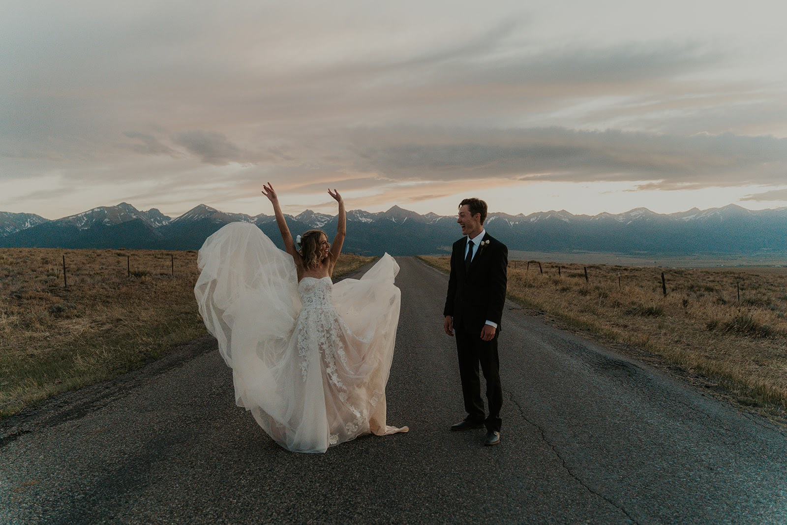 Bride and groom at sunset in the mountains