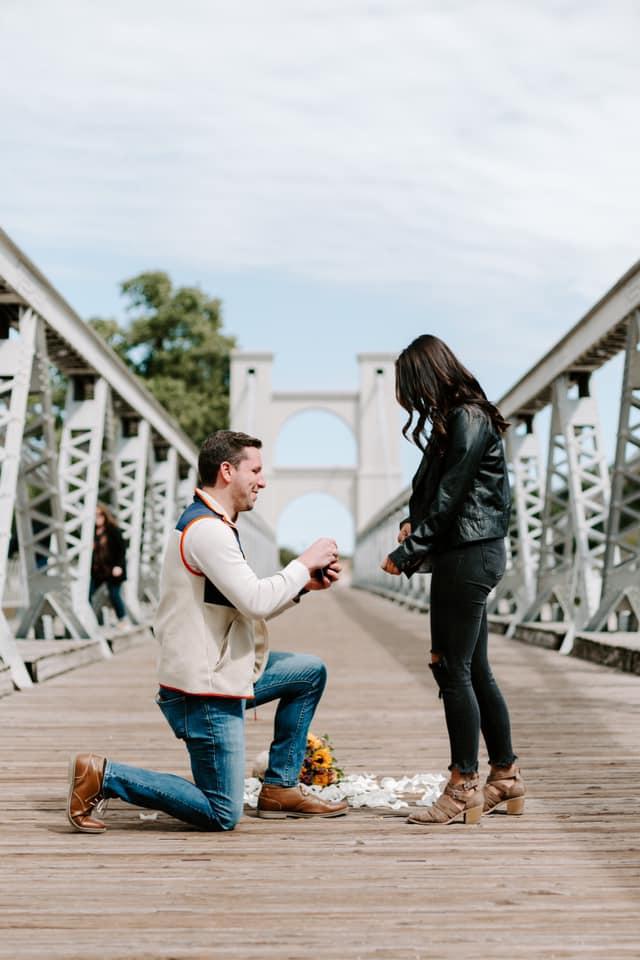 Alex proposing to Tiffani on Waco bridge
