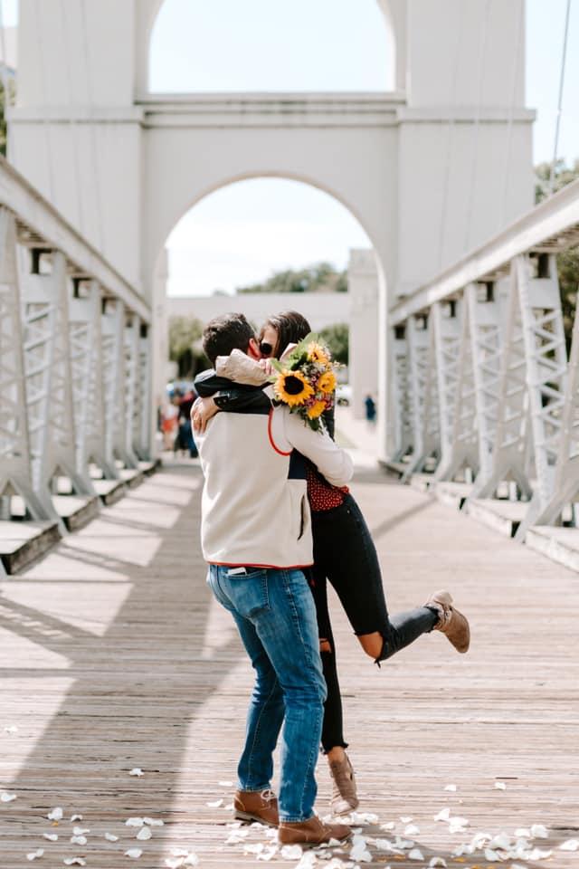 Tiffani and Alex hugging after proposal
