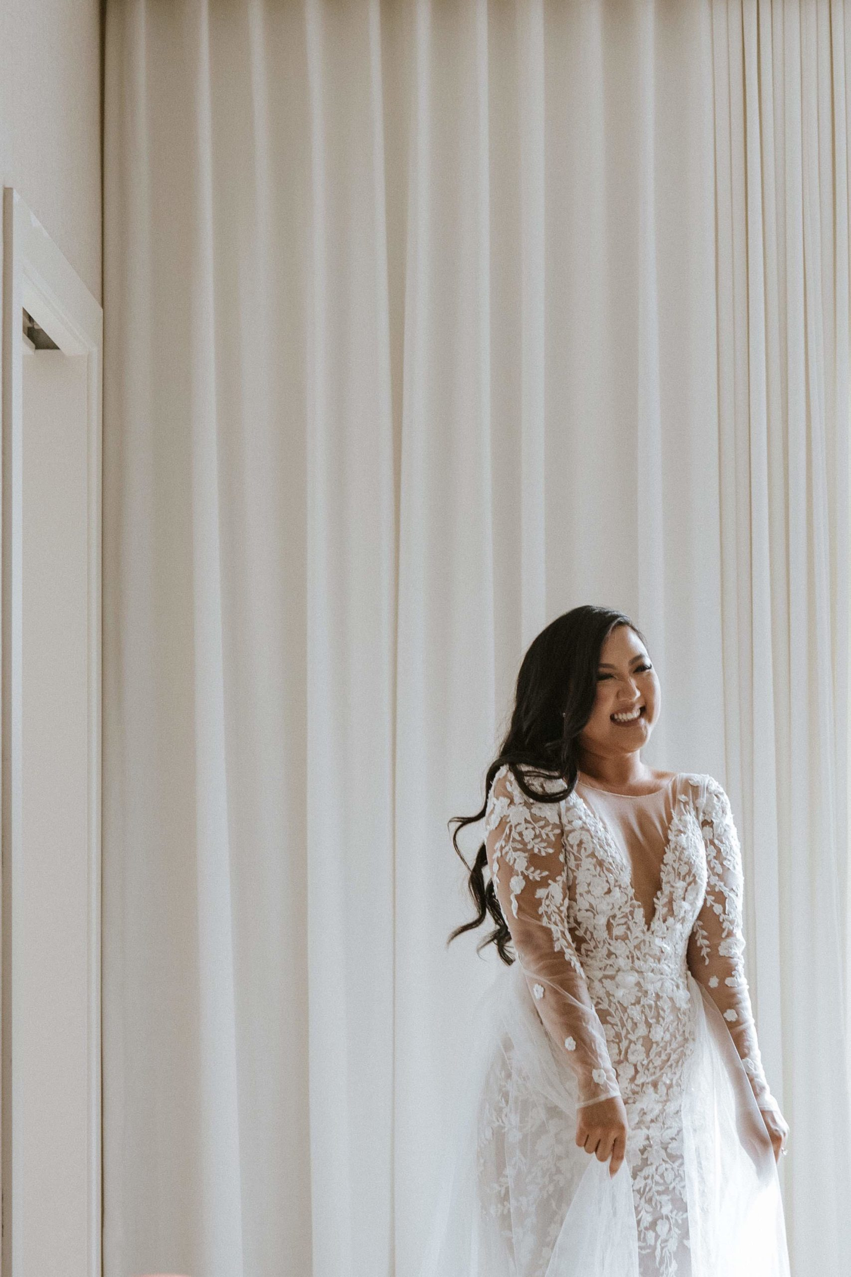 Solo shot of bride smiling in wedding dress