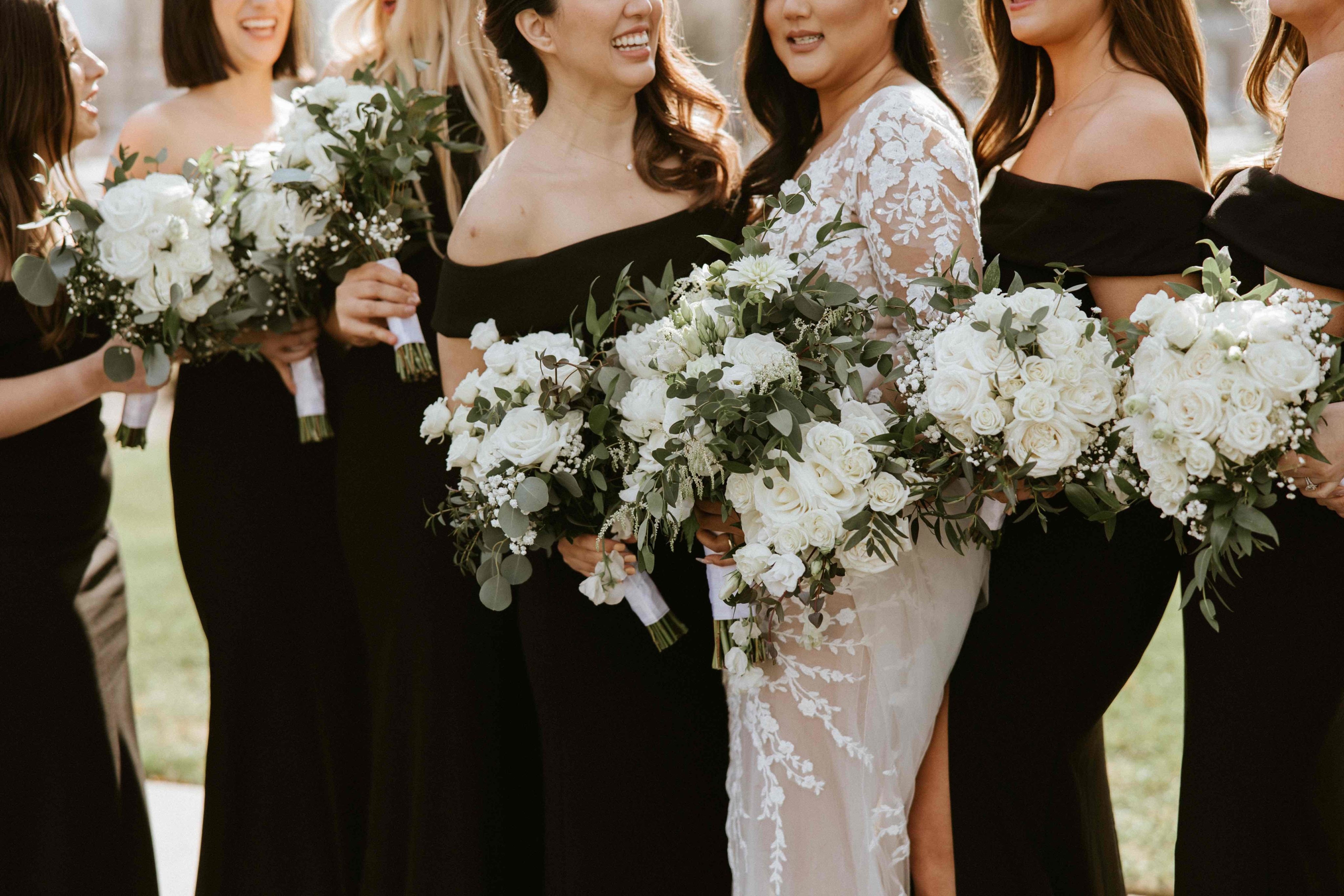 close up of bridal party dresses and bouquets
