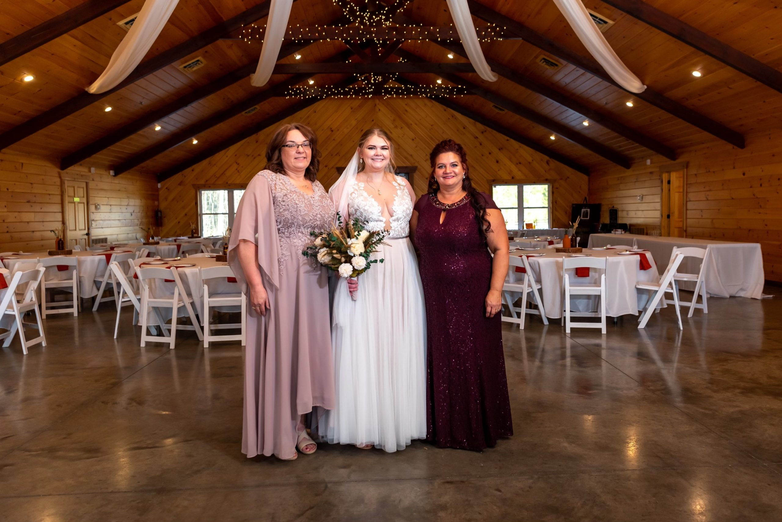 Bride with mother of the bride and mother of the groom in DB