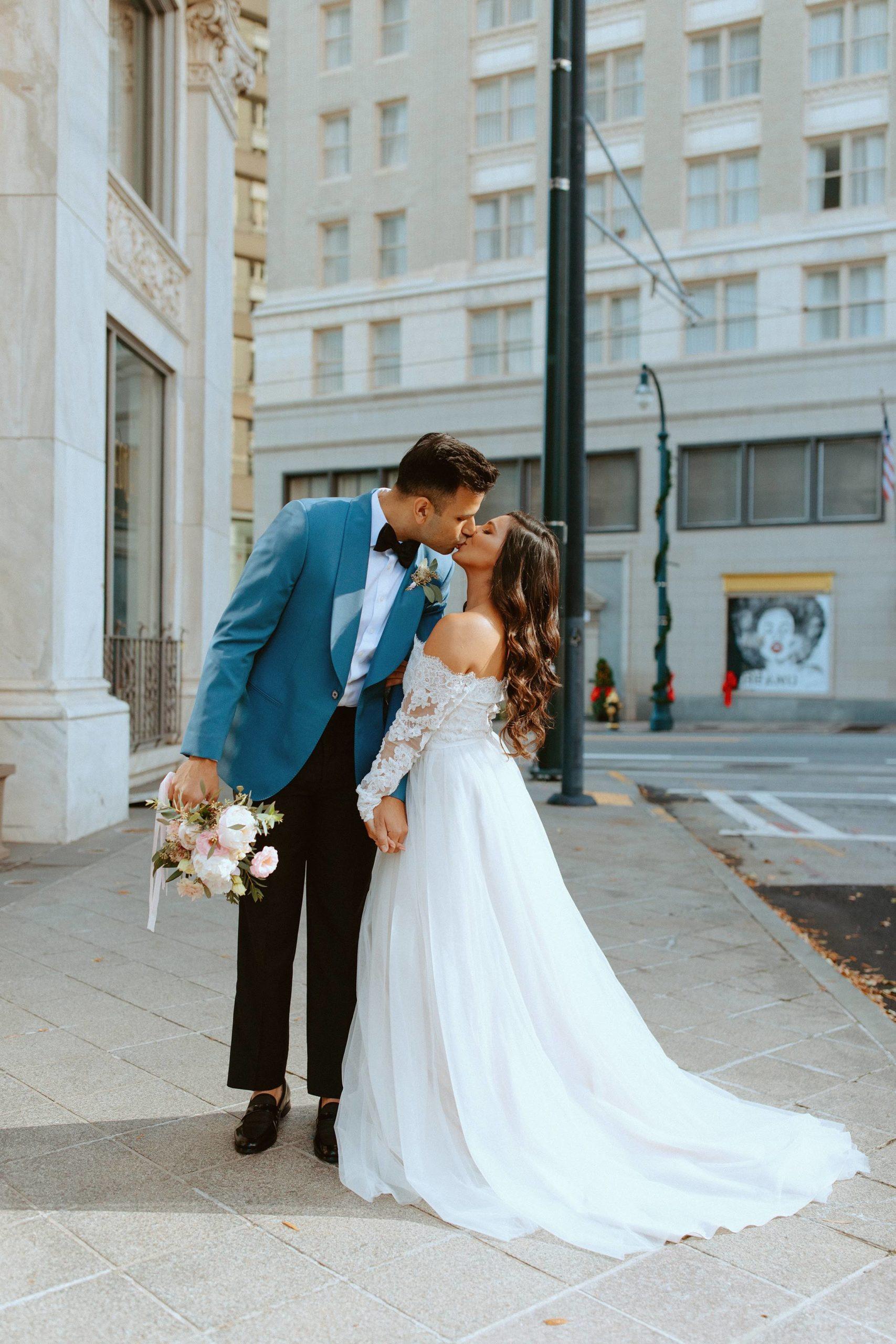 Sabrina and Sahir Kissing Downtown Atlanta