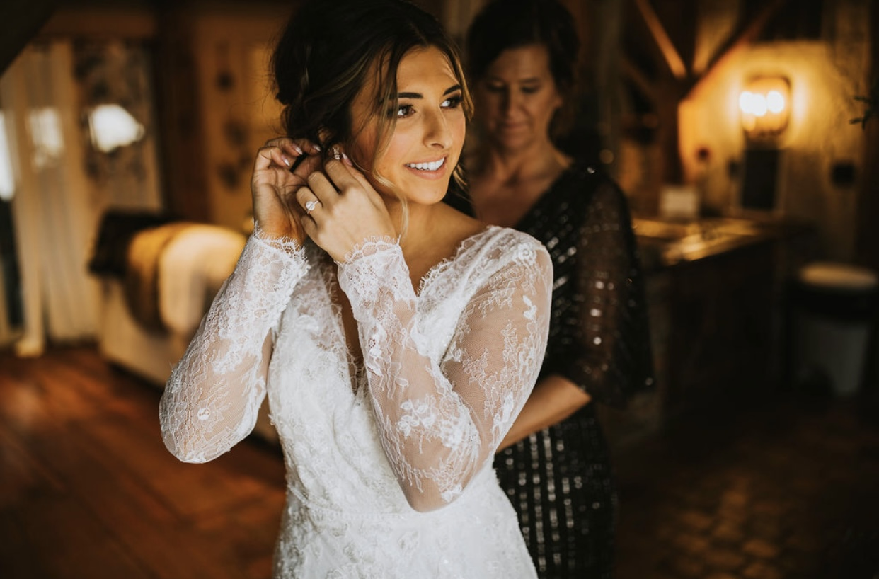 Bride getting ready with help from mom