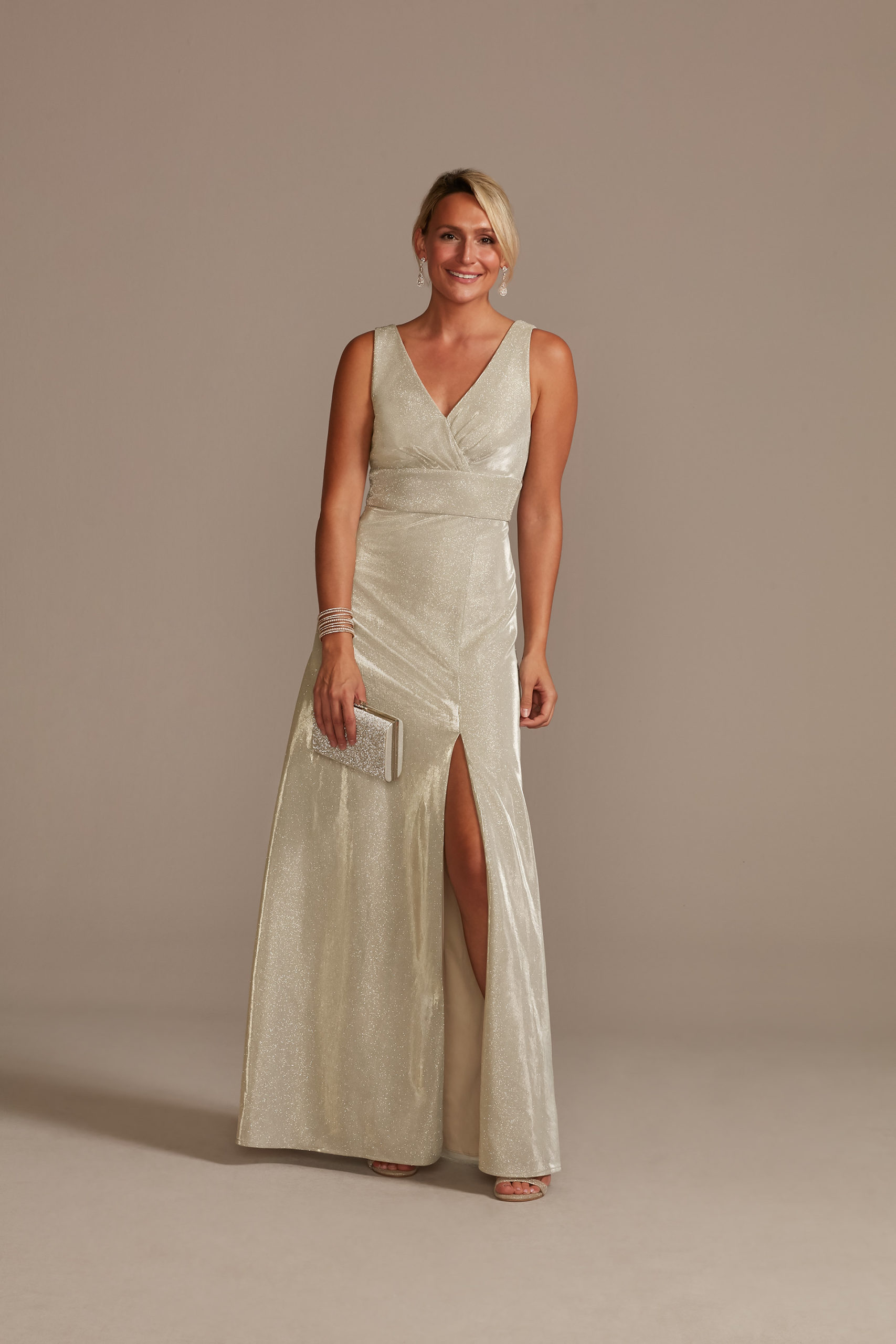 model wearing champagne metallic a-line mother of the bride dress