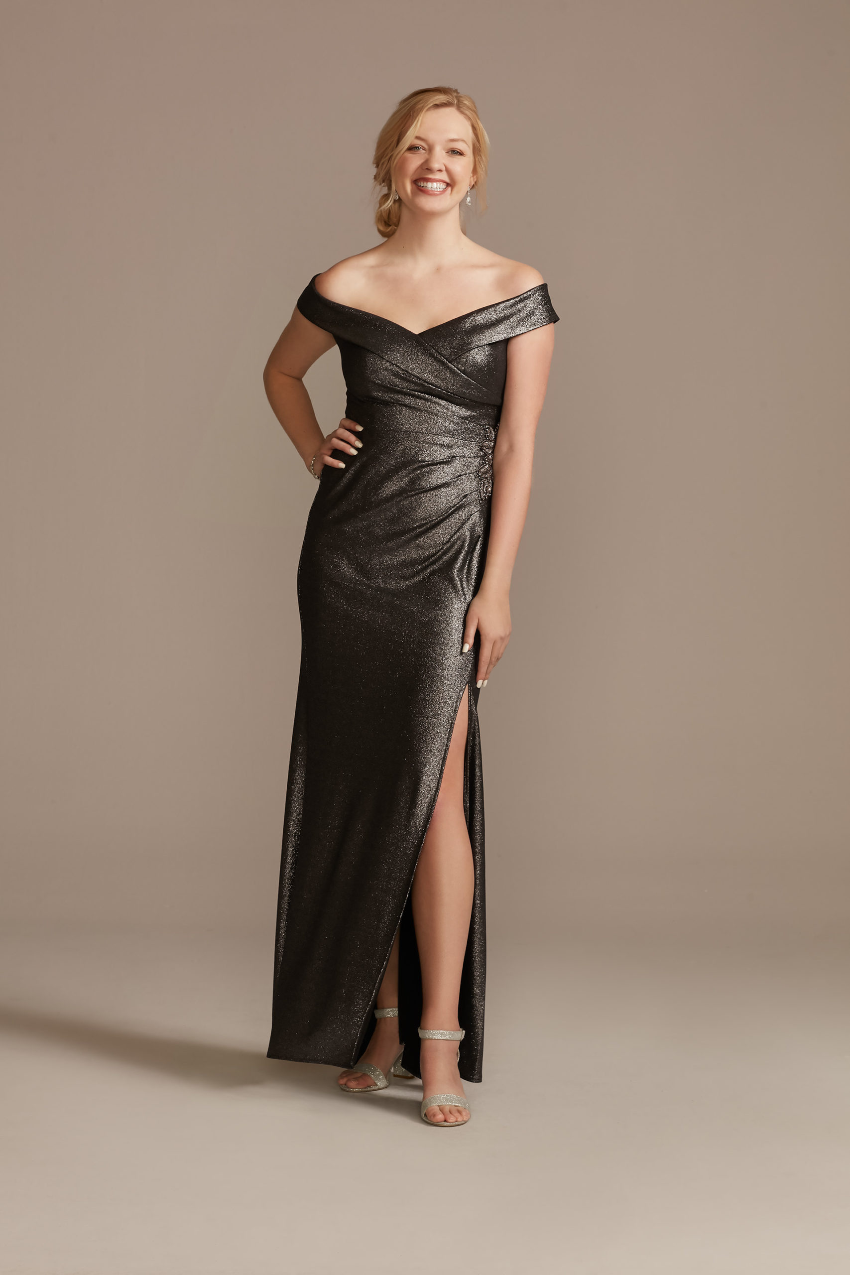 model wearing an off the shoulder gray metallic mother of the bride dress