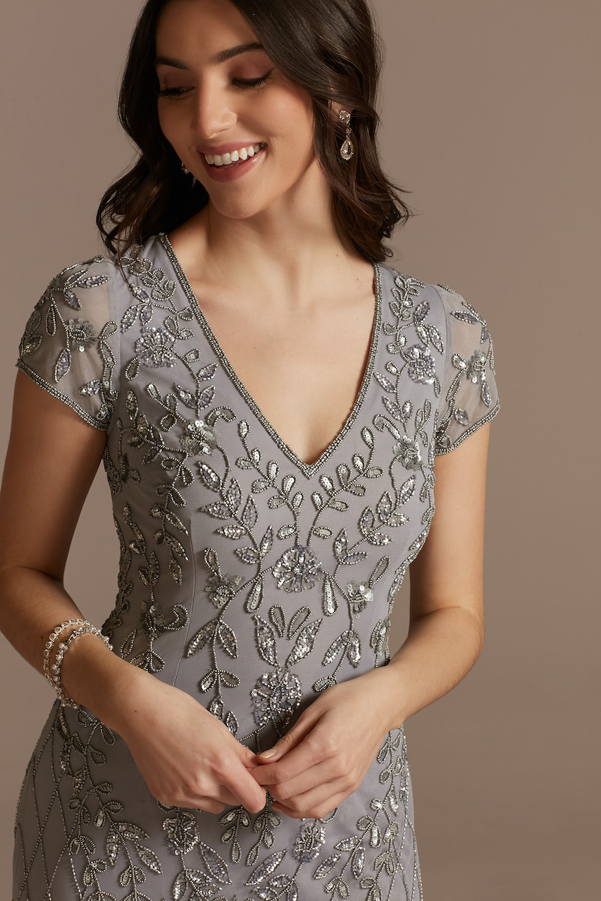 model wearing gray sheath with all over beaded pattern