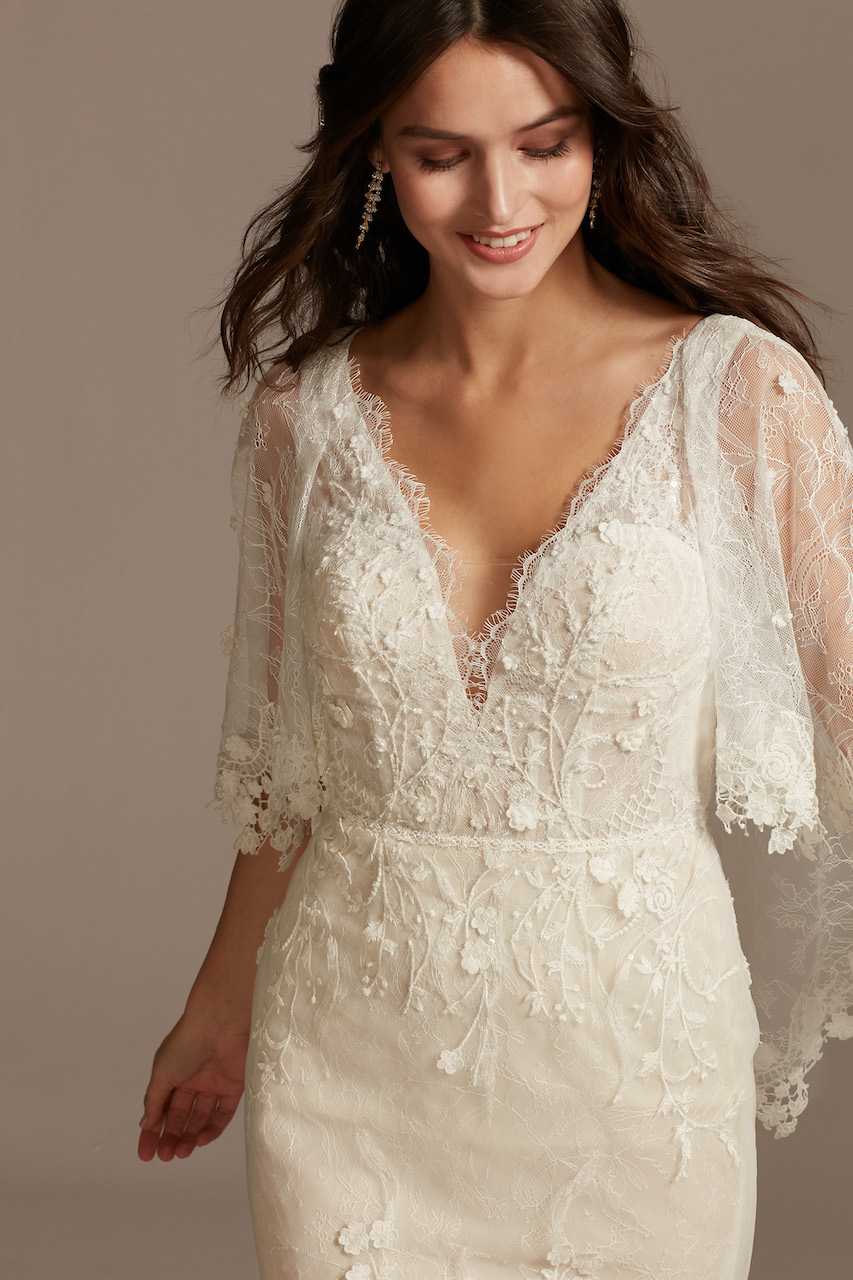 bride wearing ethereal Lace Wedding Dress with Crochet Trim Capelet