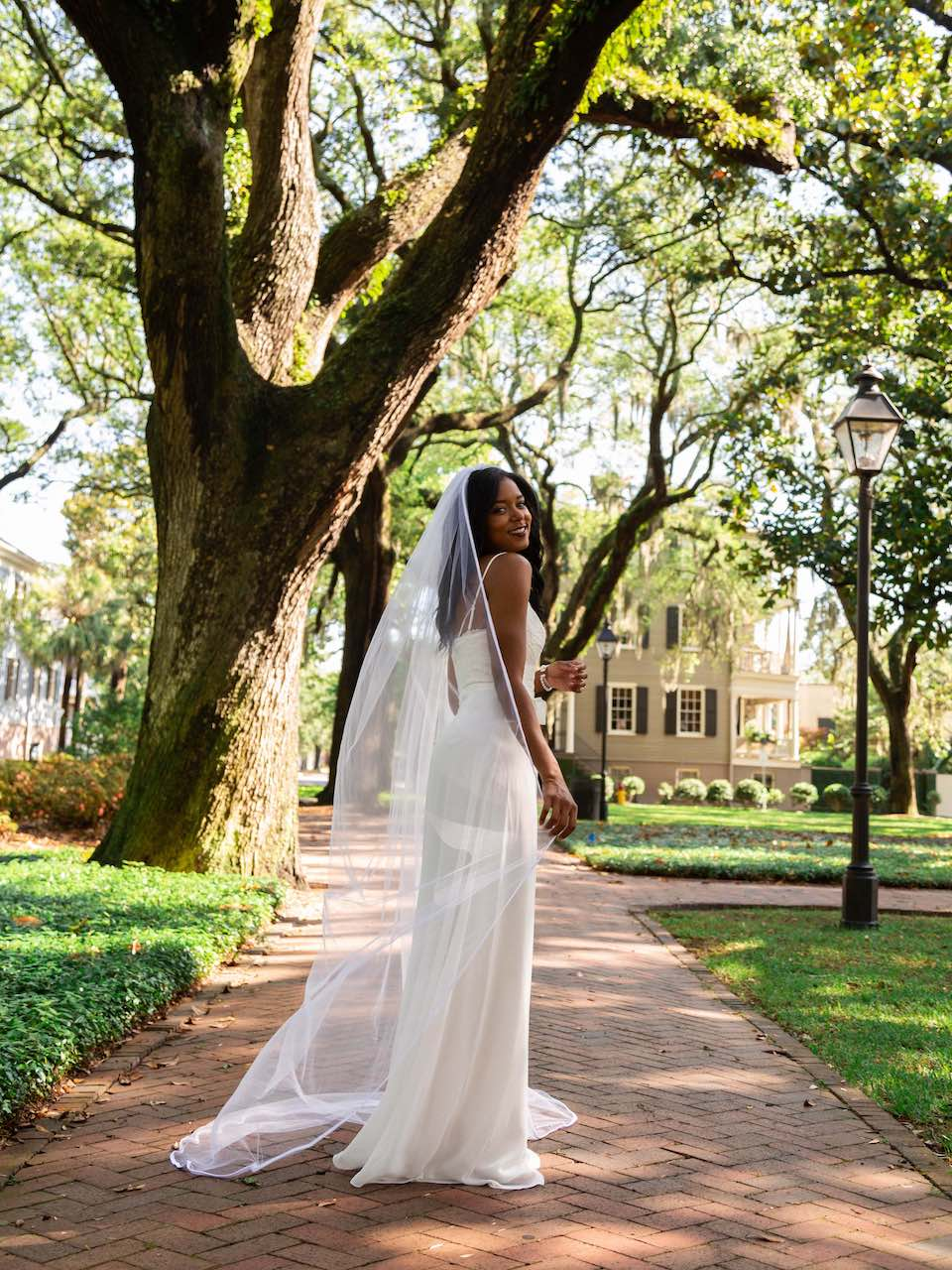 bride in a white wedding dress with a long cathedral veil