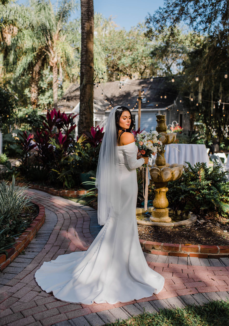bride in mermaid wedding dress with button detailing down the back