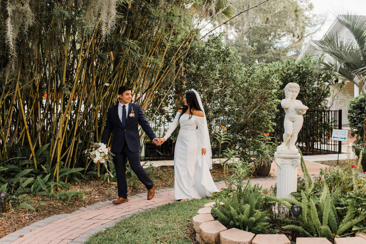 bride and groom walking at their intimate and romantic wedding in florida