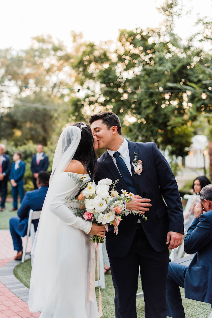 bride and groom kissing at their intimate and romantic wedding in florida