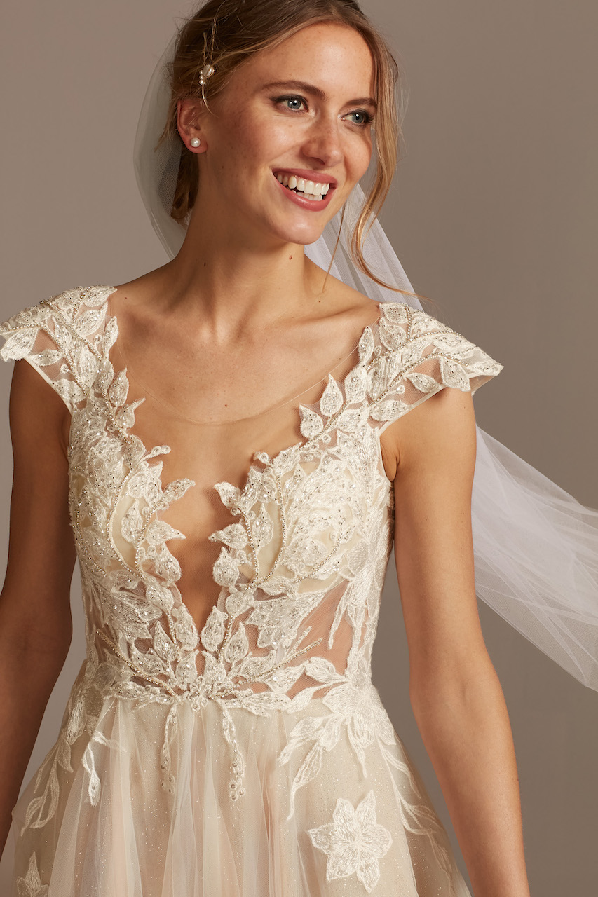 bride wearing ethereal Illusion Cap Sleeve Lace Appliqued Wedding Dress