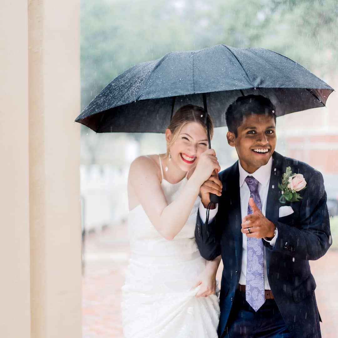 married couple under an umbrella