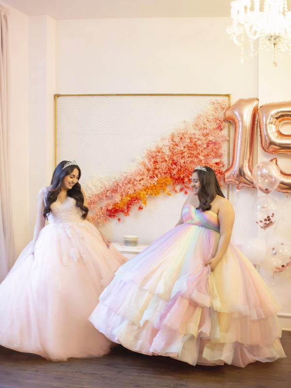 Two young ladies in pink ball gowns with tiaras