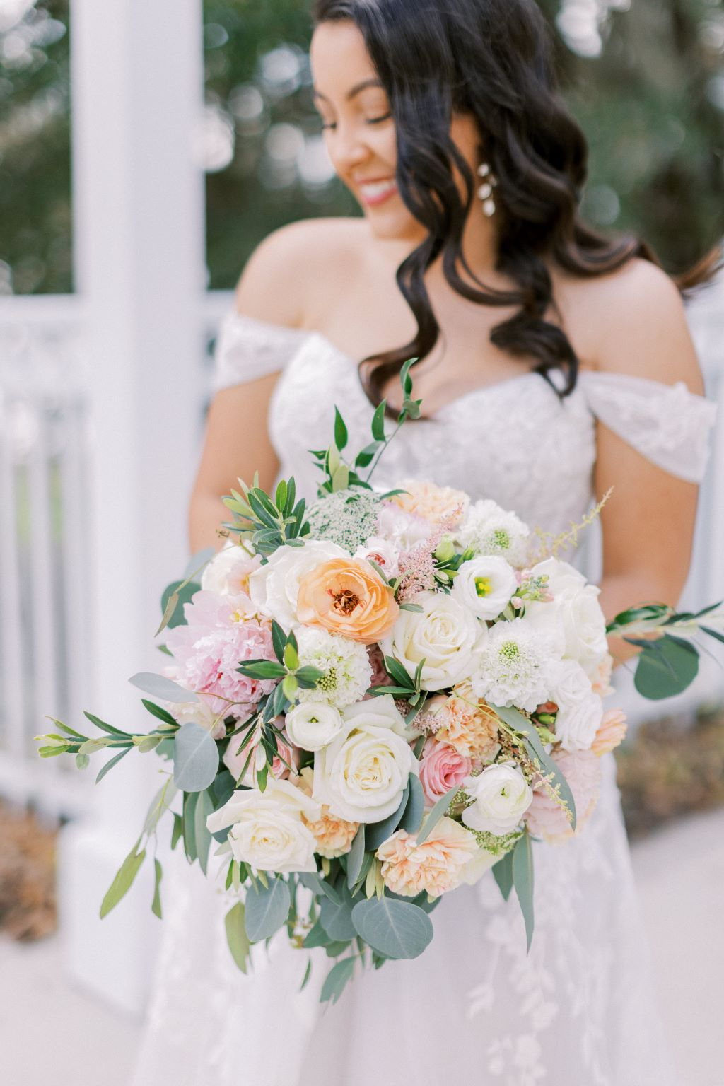 bride holds beautiful blush colored bouquet