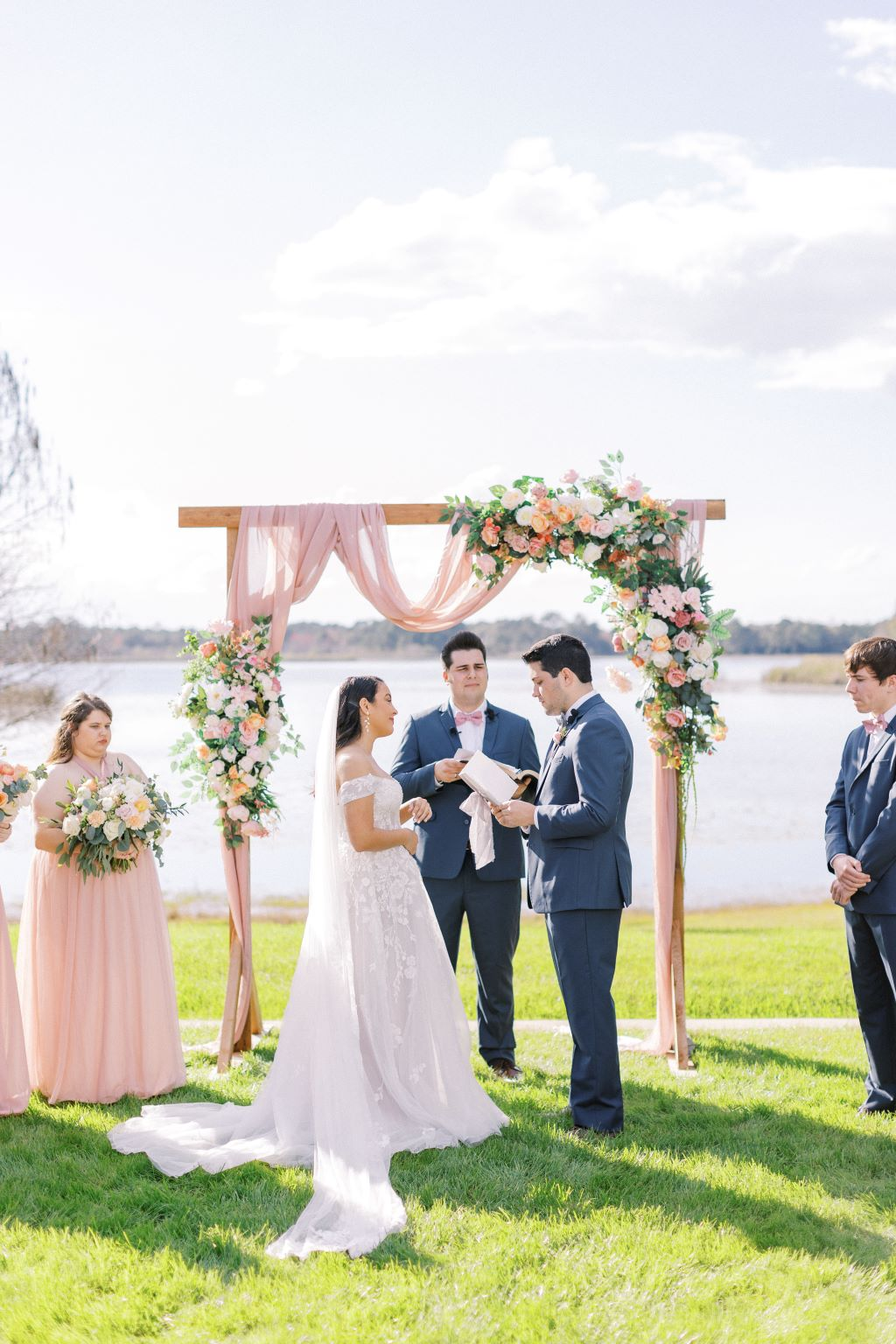 bride and groom being married by groom's brother at their bright and airy springtime wedding