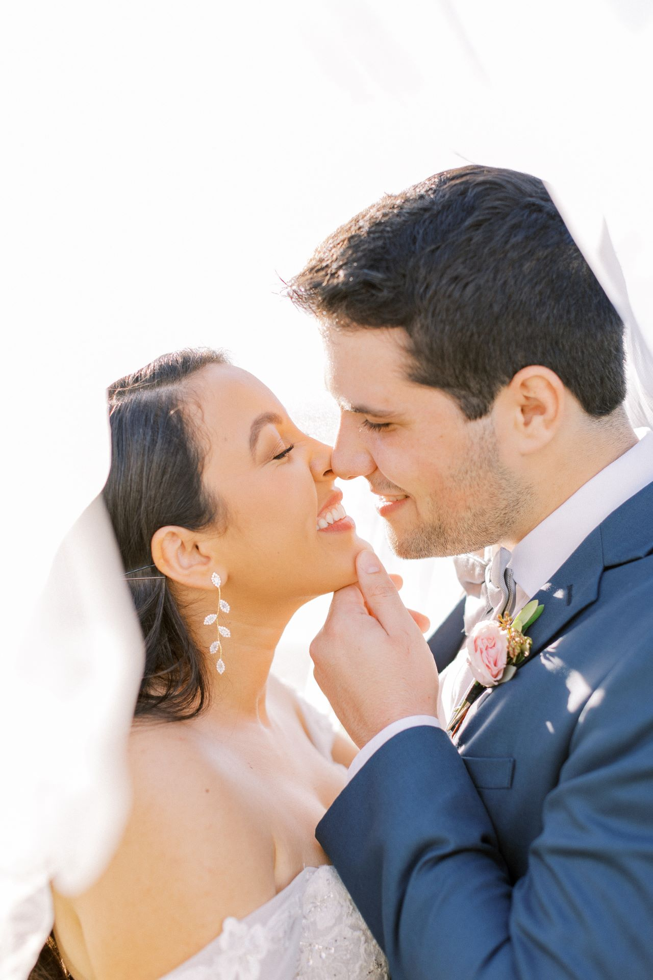 bride and groom embrace in romantic lighting