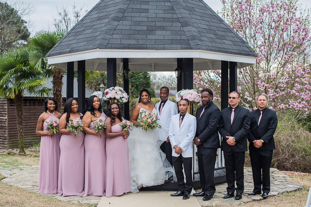 outdoor fairytale wedding bridal party