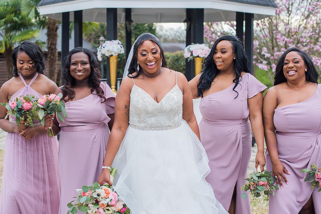 bride and bridesmaids at outdoor fairytale wedding