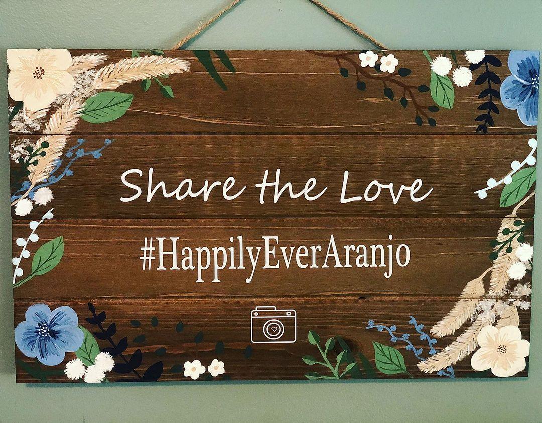 "wedding hashtag idea sign that reads ""#HappilyEverAranjo"""