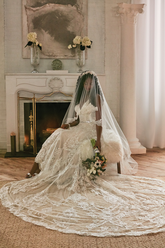 bride wearing embellished wedding dress with cathedral length train