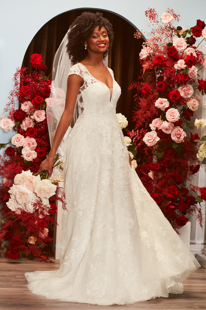 bride wearing 2021 fall wedding dress embellished with lace and parkles