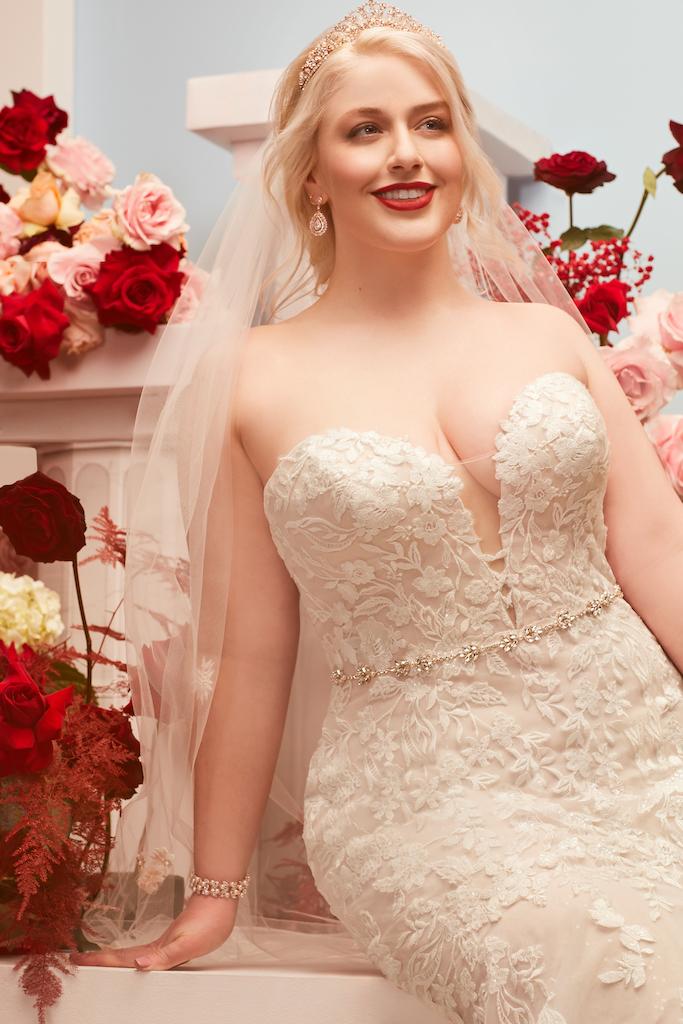 bride wearing classic wedding dress from exclusive bridal brand oleg cassini
