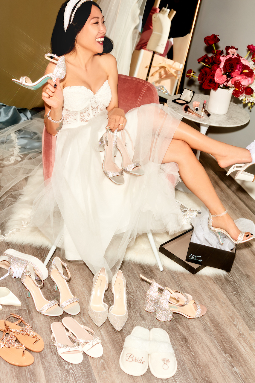 bride surrounded by shoes