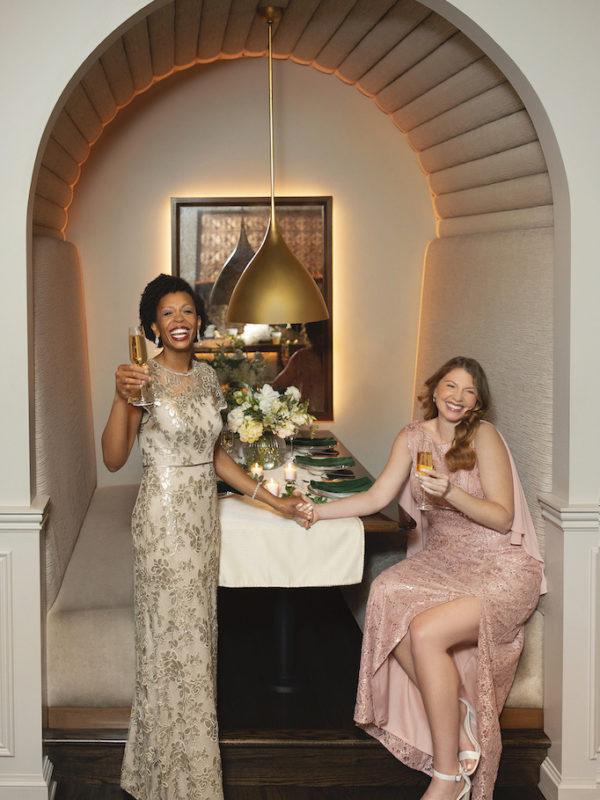 two mom's a wedding reception wearing formal wedding attire