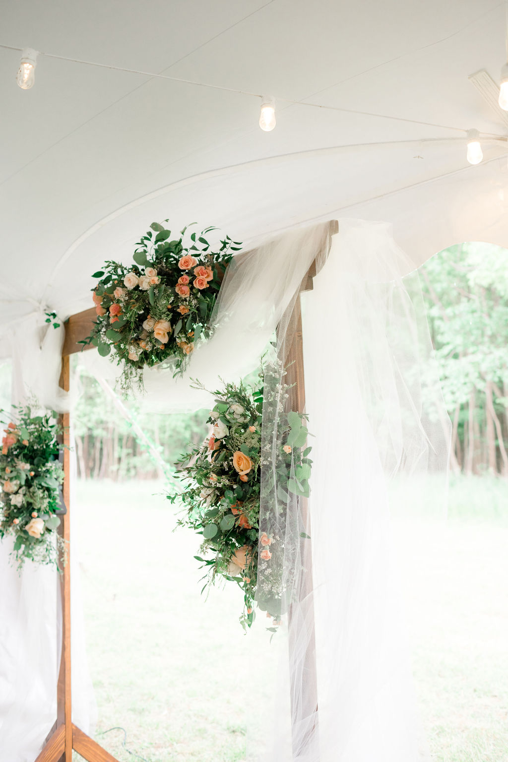 ceremony arch with flowers for dreamy springtime wedding