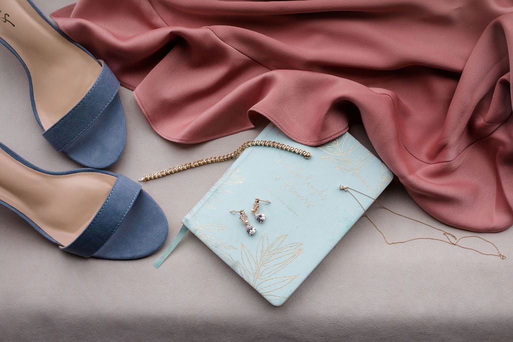 flatlay of wedding shoes and jewelry for dreamy springtime wedding
