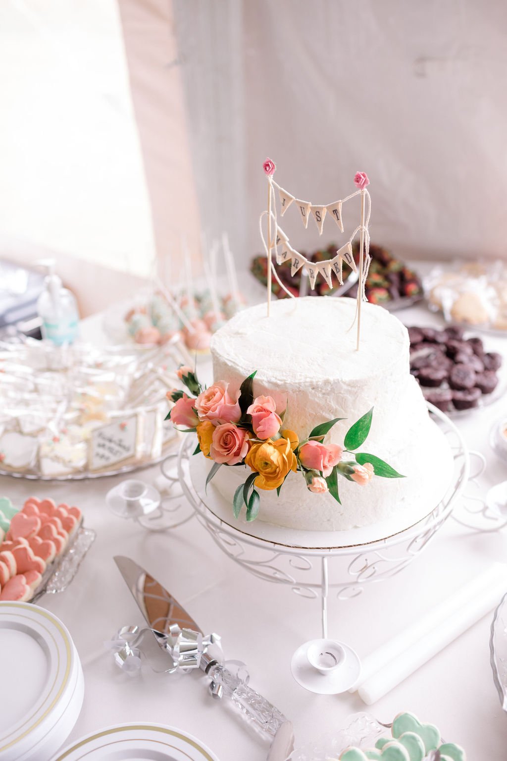 dreamy springtime wedding cake with white frosting