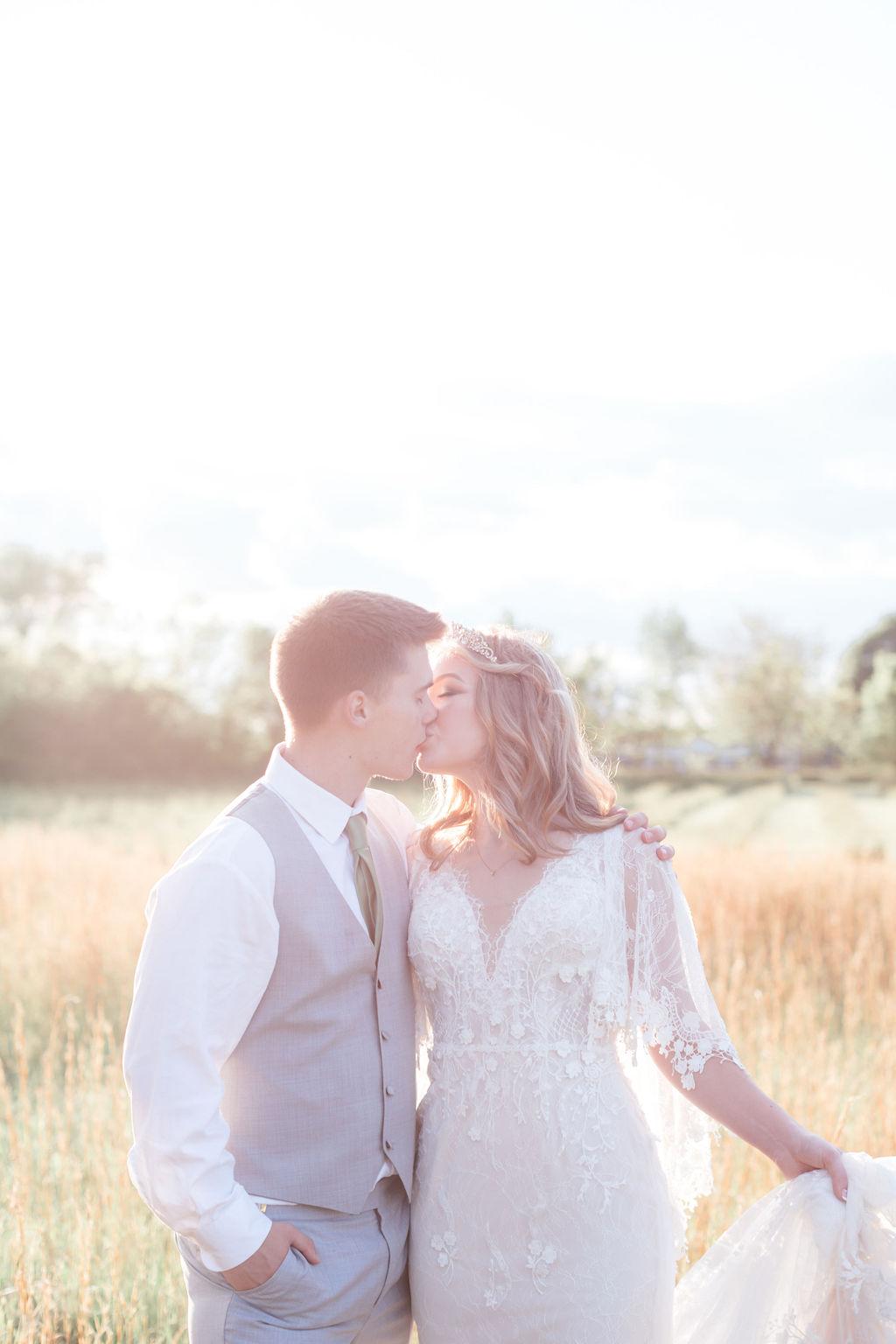 bride and groom kissing at golden hour