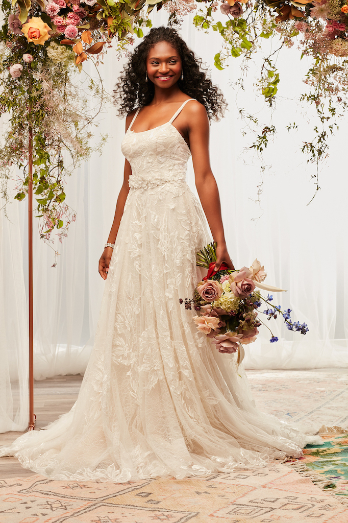 bride wearing fall 2021 wedding dress with sparkle and lace