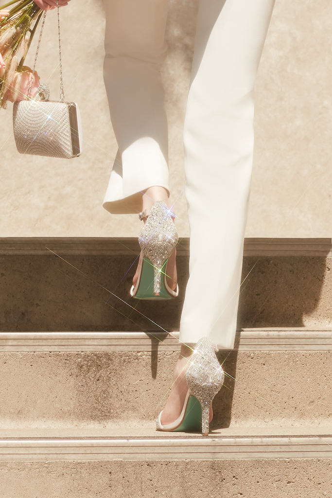 women walking up stairs in sparkling stilettos for a courthouse wedding