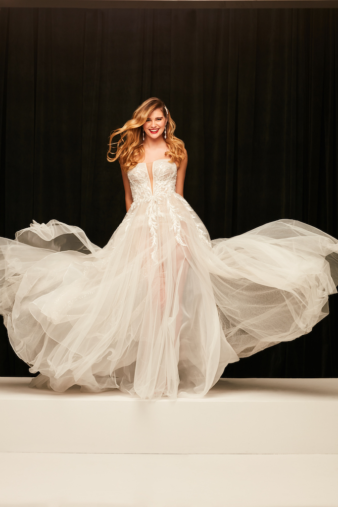bride wearing 2021 fall wedding dress with lace appliques