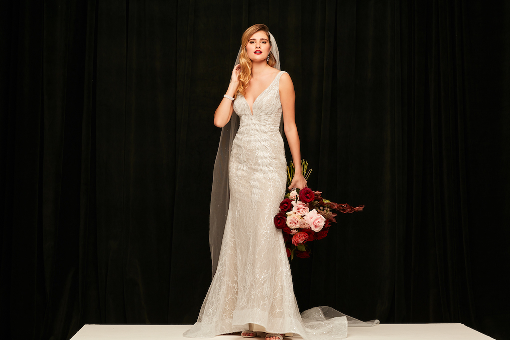 bride wearing sheath style dress from the exclusive bridal brand galina signature