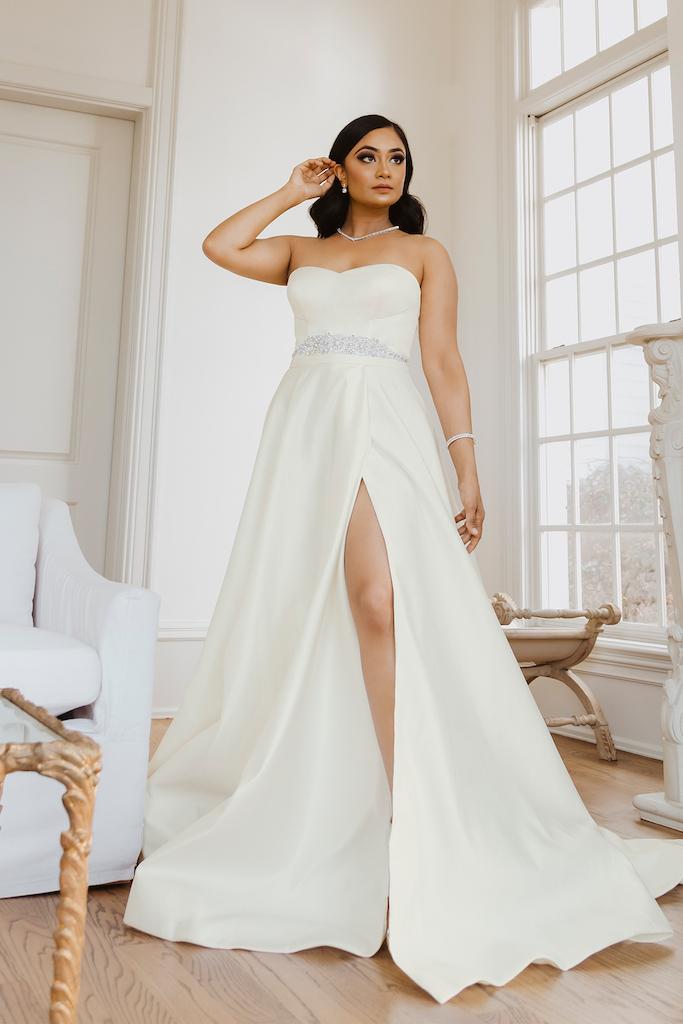 bride wearing modern wedding dress from exclusive bridal brand DB Studio