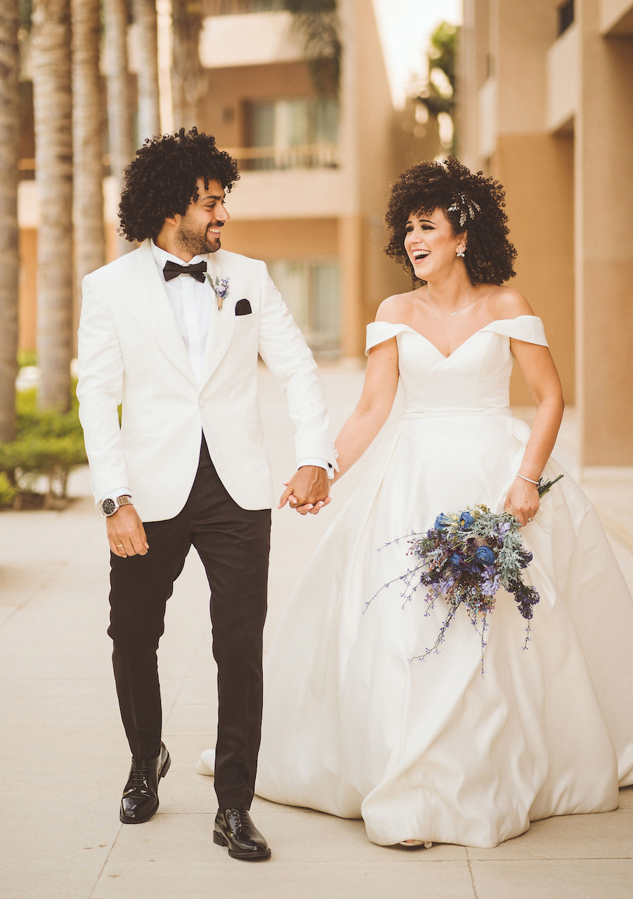 couple walking hand in hand at romantic and intimate wedding in egypt