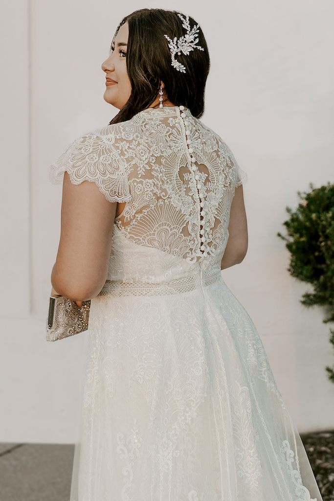 bride wearing boho inspired dress from exclusive bridal brand melissa sweet