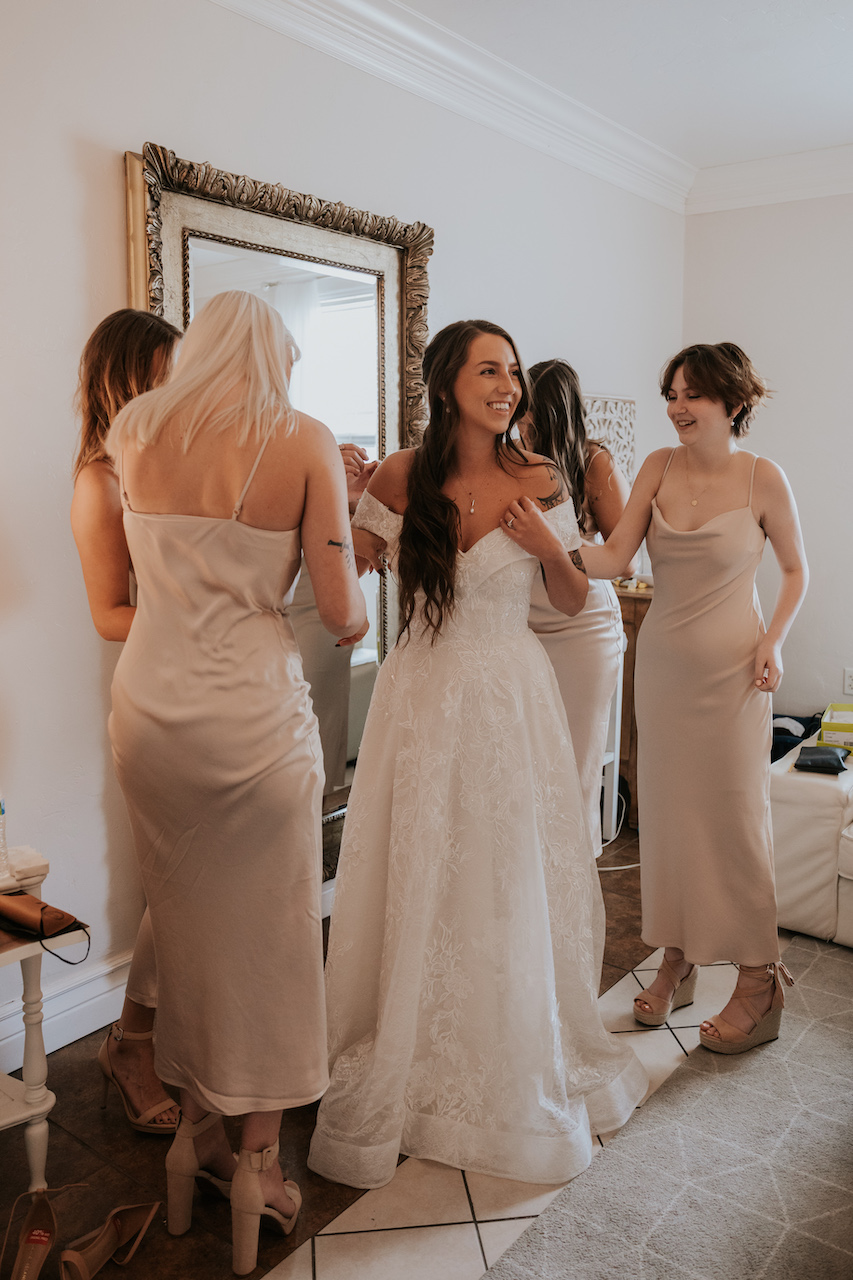 bride and bridesmaids getting ready at simple and elegant greenhouse wedding