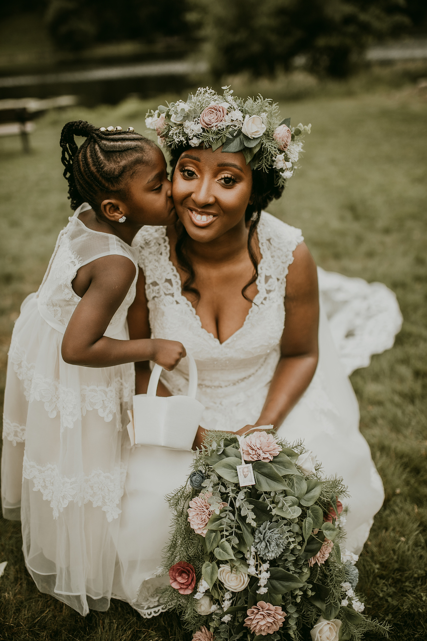 bride and flower girl at rustic outdoor wedding