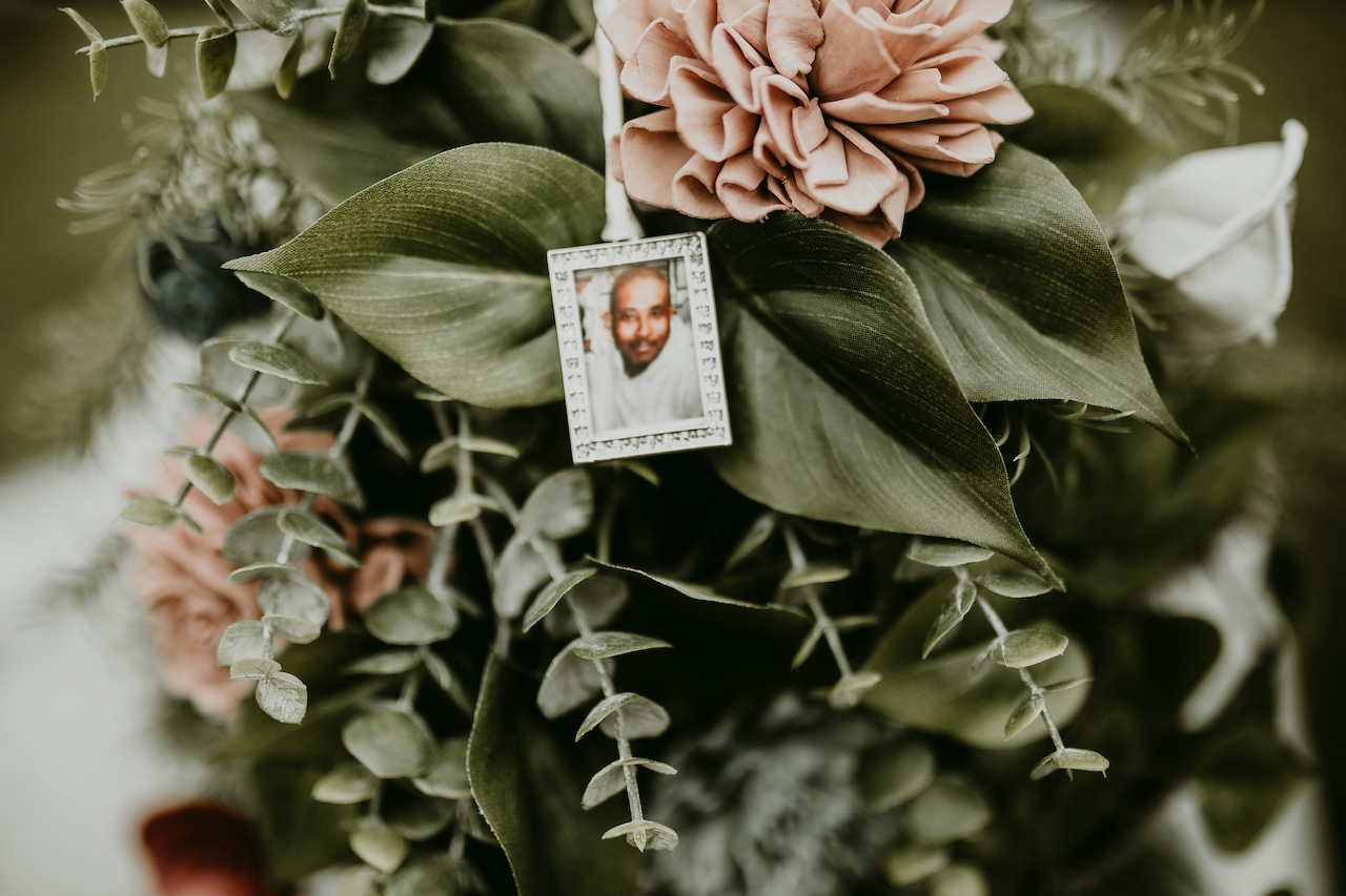 photo of bride's father on bridal bouquet