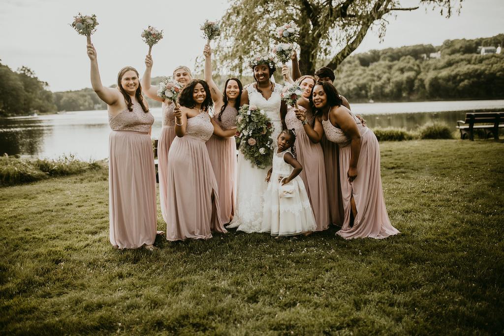 bride and bridesmaids at rustic outdoor wedding