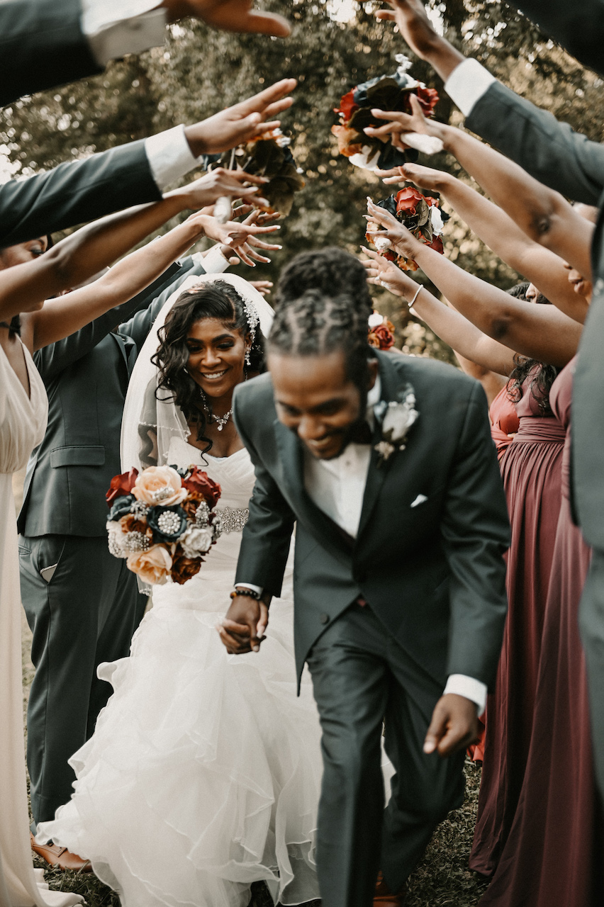 bride and groom smiling at simple and elegant fall wedding