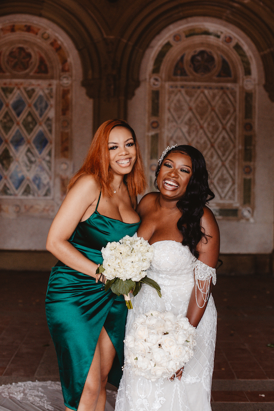 bride and bridesmaid smiling at wedding in new york city