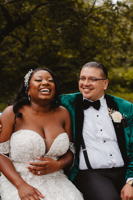 bride and groom laughing at wedding in new york city